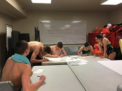 swimmers signing thank you cards (Sarah McChesney photo)