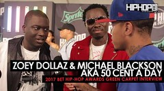 """Michael Blackson & Zoey Dollaz Talk """"50 Cent a Day"""", the Upcoming """"50 Cent a Day"""" Album, Their Favorite Song of the Summer & More on the 2017 BET Hip-Hop Awards Green Carpet (Video)"""