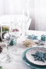 Table served for Christmas dinner in living room,