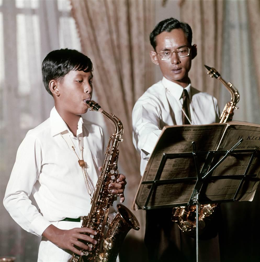 King Bhumibol playing saxophone with his son, Vajiralongkorn, the future King Rama X. Photo taken on September 4, 1960.