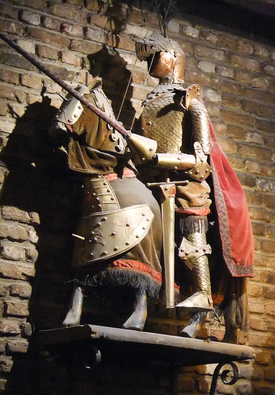 A knight in armour astride a horse at Toon, a historical pub in Brussels, Belgium
