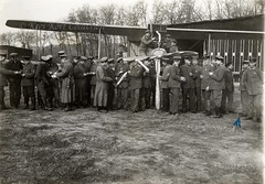 A lot of men busy for the camera and in the background an Albatros C.III biplane. On the reverse is given that this is Rumania in 1917 [Germany, 1915]