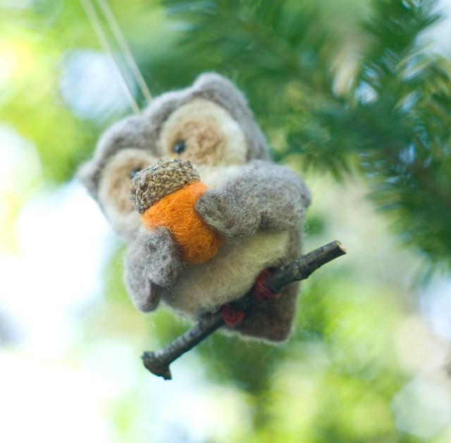 Owl holding acorn