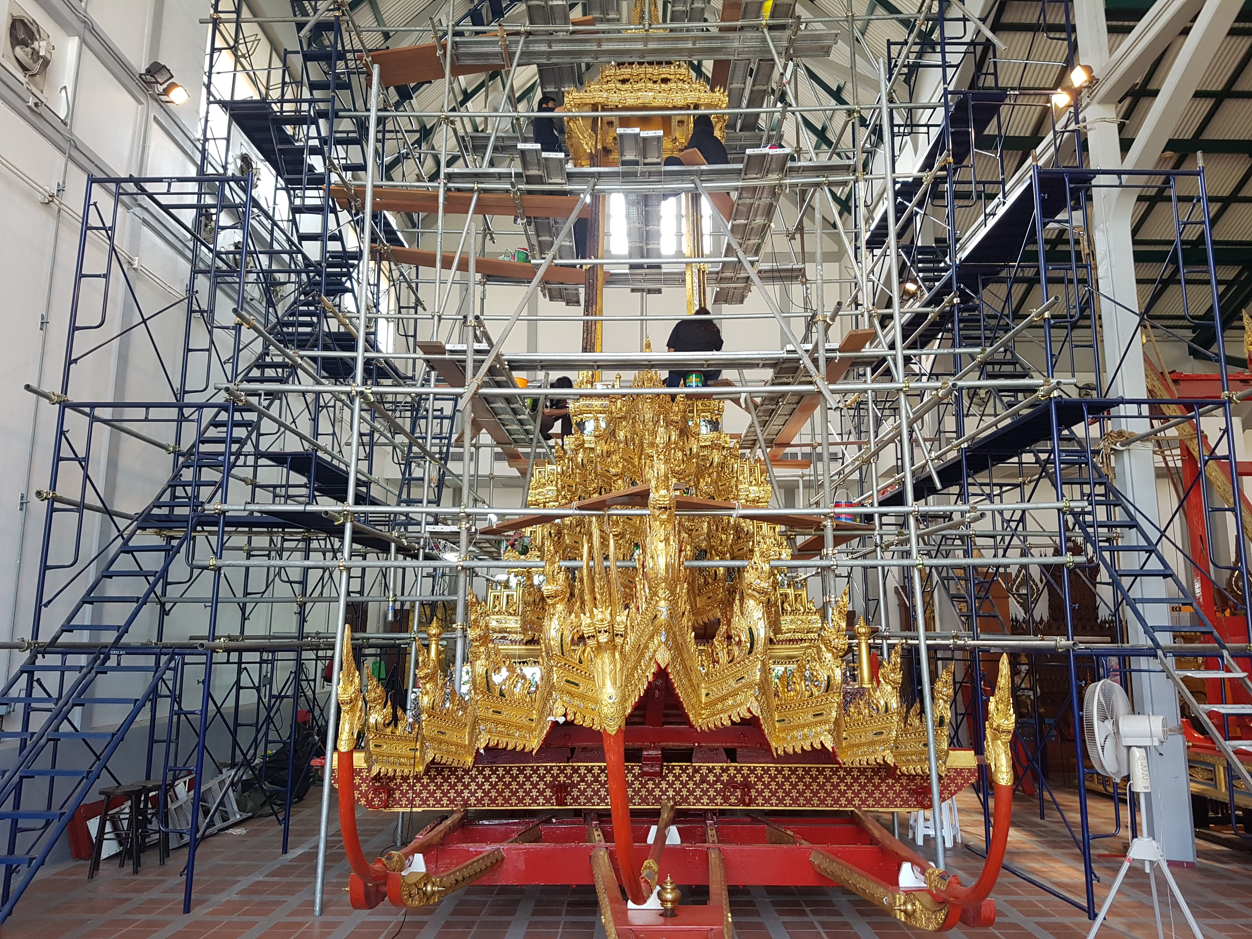 Preparing the Great Chariot of Victory at Chariot Hall in the Bangkok National Museum. This royal chariot was built in 1795-96. Photo taken on April 22, 2017