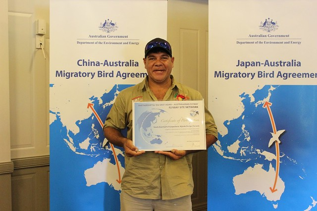 Gangalidda Traditional Owner and Gangalidda & Garawa Ranger Coordinator, Terrence Taylor, accepts the Nijinda Durlga (Tarrant) Certificate of Participation at 2016 Bilateral Migratory Bird Agreement Consultative Meetings between the Governments of Australia, Japan, China and the Republic of Korea in Cairns, Australia