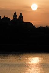 Paddle surfing at the Sunset, Donostia-San Sebastian.