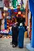 Veiled women in djellaba walking in medina, Chefchaouen, Morocco by Alex_Saurel