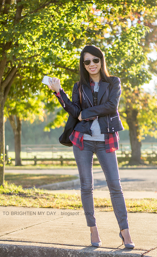 black leather jacket, red buffalo check plaid shirt, gray tee with Mickey, gray skinny jeans, gray suede pumps