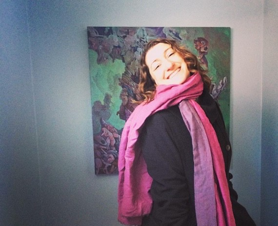 Heather Adels, Rhode Island artist, standing in front of one of her works