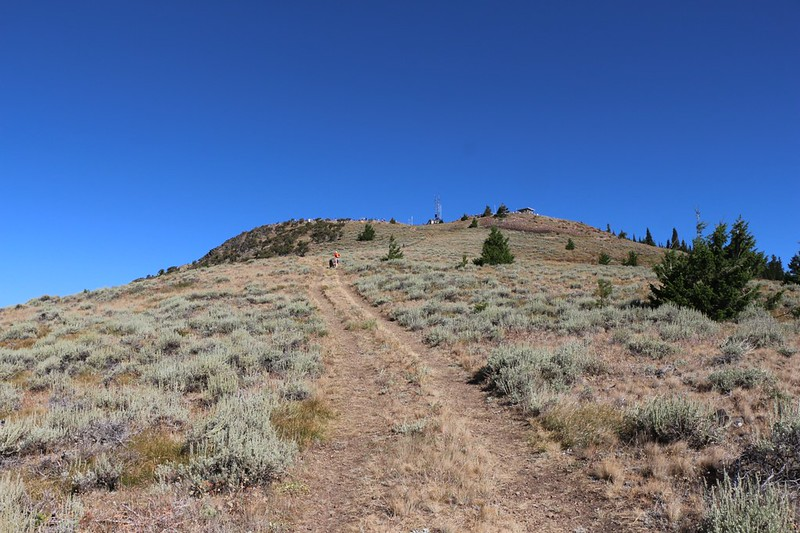 We begin climbing the steep slope to the Dixie Butte summit in order to join the solar eclipse party