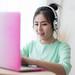 Young Asian woman using laptop computer