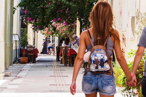 nafplio street streetphotography back bicycle citylife day flowers girl greece guy handinhand life nauplia people perspective priest realpeople rearview restaurant shorts summer rawstreets beauty woman