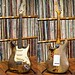 Rory's 1961  Fender Stratocaster front and back, standing in front of Rory's vinyl collection.