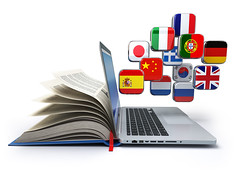 E-learning or online translator concept. Learning languages online. Laptop, book and flags. 3d illus