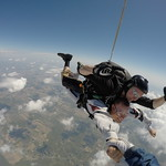 Tandem Student Ryan In Freefall Featuring Instructor Rick Sales and Videographer Jeff McCarty