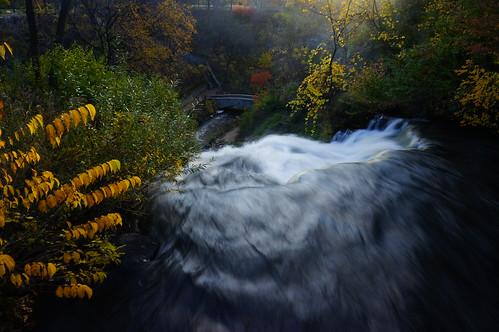 waterfall water motion autumn autumnleaves fallcolors bridge sunriselight