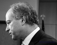 Side View of Senator O'Ban in Black & White With the Press