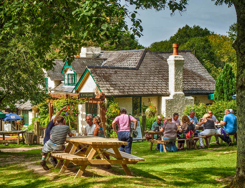 Families enjoy a Sunday lunch outside the High Corner Inn in the New Forest. Credit Anguskirk, flickr