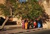 Morrocan veiled women walking through fortress walls door, Taroudant, Morocco by Alex_Saurel