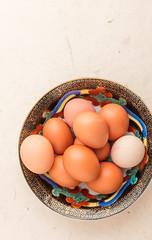 Eggs in a black decorative bowl.