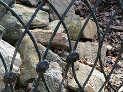 Fence And Rocks.