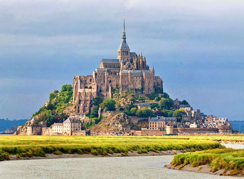 Mont Saint-Michel as viewed along the Couesnon River in Normandy, France. Credit David Iliff