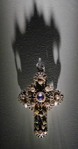 Jewelry in the form of a detailed gold cross in the Decorative Arts Museum in Dublin, Ireland