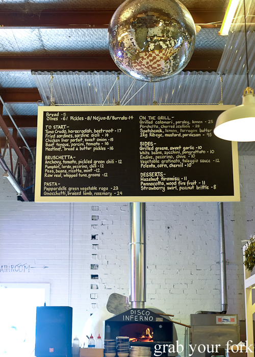 Menu and disco ball at Mr Liquor's Dirty Italian Disco by Pinbone at the Tennyson Hotel Bottle Shop in Mascot