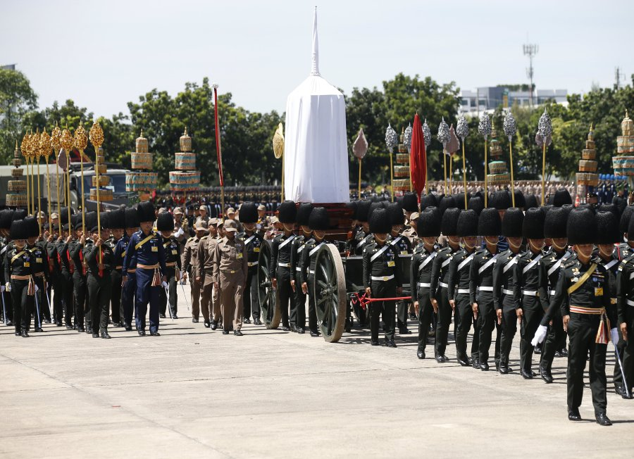 Officers of the Royal Thai Army and royal officials participate in a training exercise to pull a funeral chariot which will be used in the procession of the late King Bhumibol Adulyadej's cremation ceremony. The royal cremation is scheduled for October 26, 2017, and the funeral will consist of a five-day ceremony. Photo taken by Narong Sangnak at the 11th Infantry Regiment King's Guard in Bangkok on September 28, 2017.