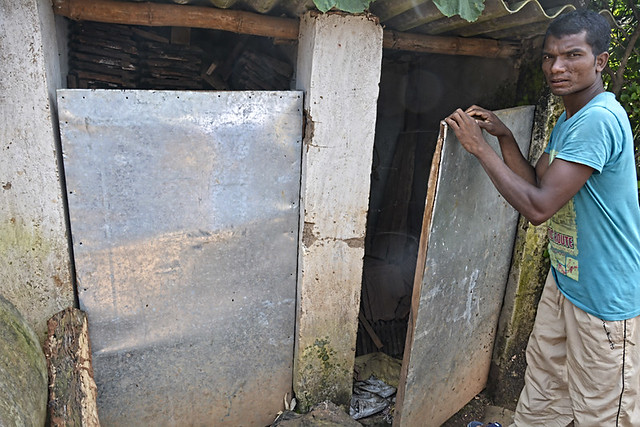 A villager shows a defunct toilet.