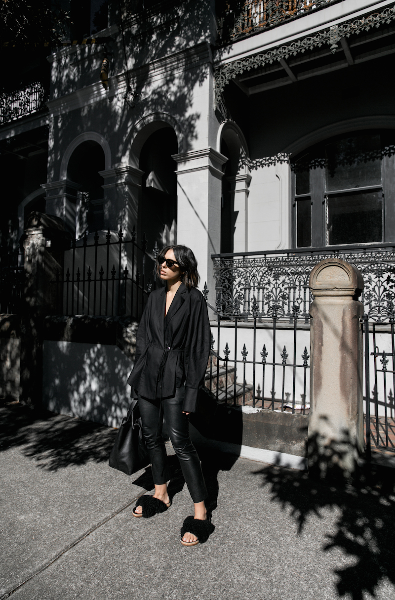 all black outfit minimal street style oversized shirt leather pants shearling slides fashion blogger michael lo sordo shirt bassike chloe kaity modern legacy Instagram  (4 of 7)