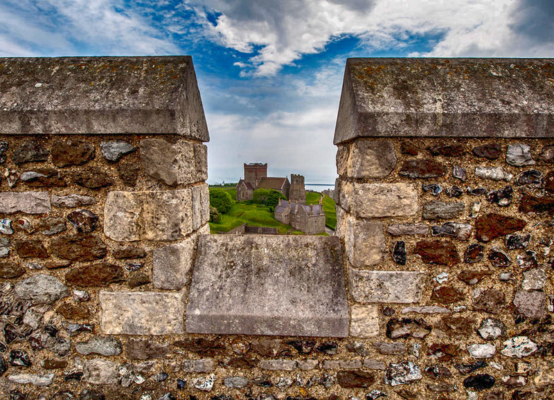 St Mary de Castro and Roman Lighthouse seen through an embrasure of the Dover Castle Keep, Dover, Kent, England. Credit Jim, flickr