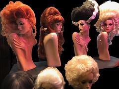 wig shop window reflections