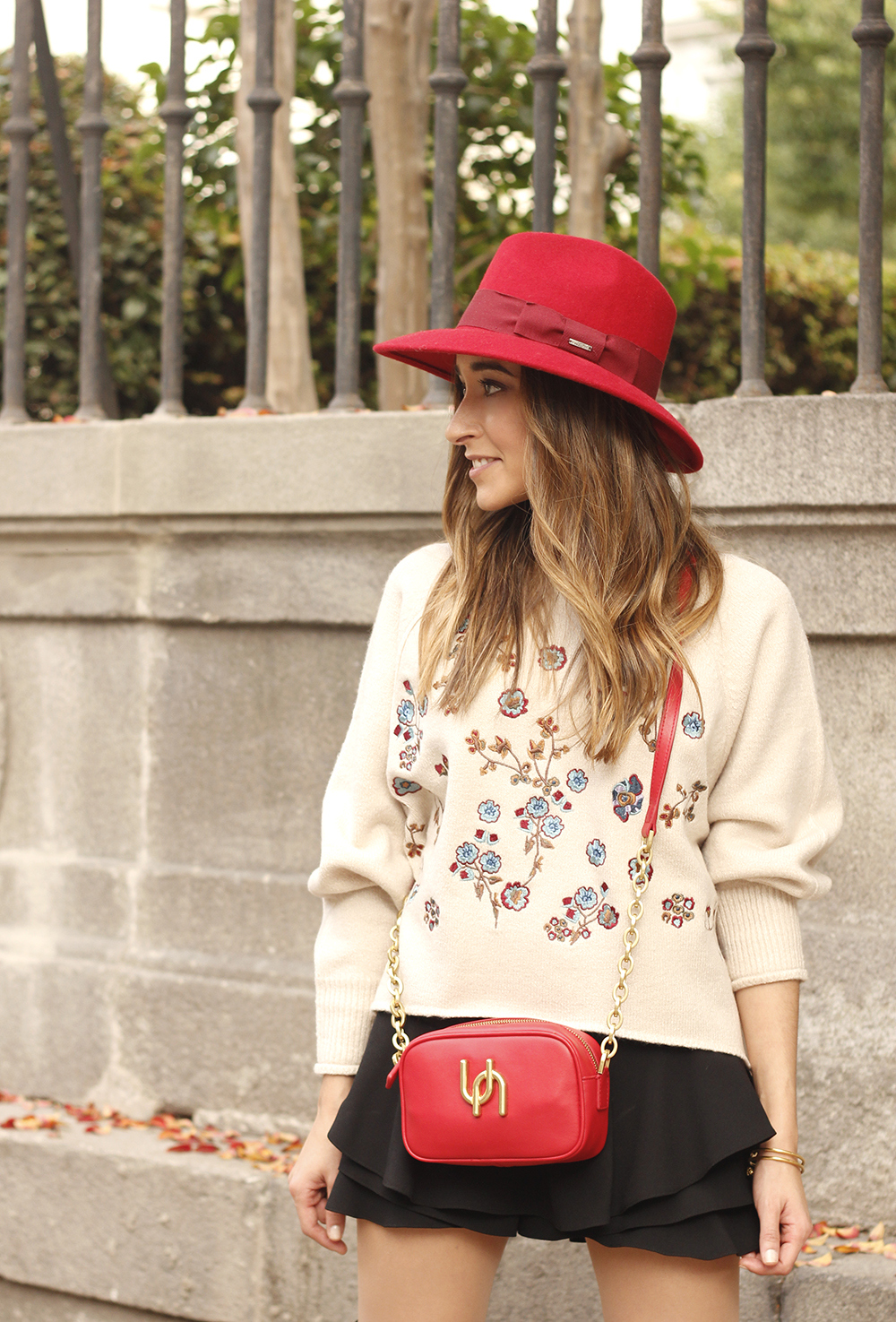beige jersey with embroidered flowers over the knee black boots red hat street style fashion inspiration outfit11