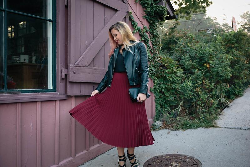 Fall Fashion Black Moto Jacket Twirling Burgundy Pleated Midi Skirt