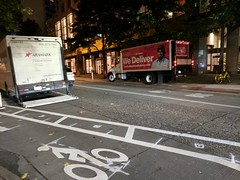 Protected bike lane and bus lane flex load zones in use as designed on Pike.