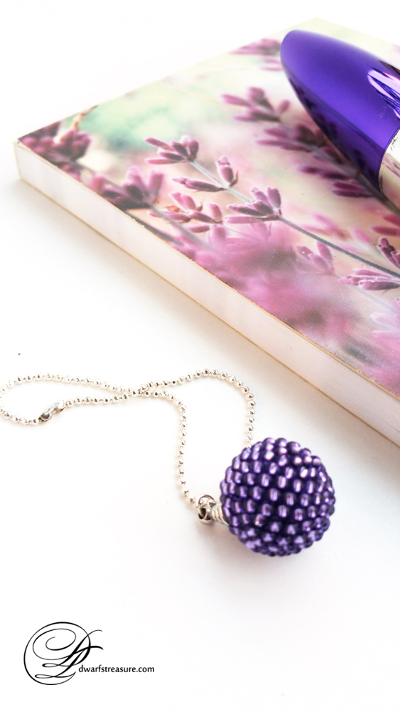 stylish purple beaded bead charm and lavender notebook