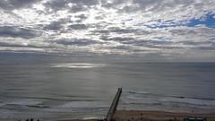 Pier under a Cloudy Ocean