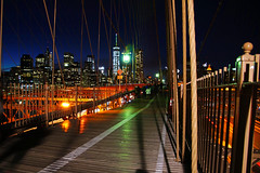 NYC by night. Wooden deck of Brooklyn Br