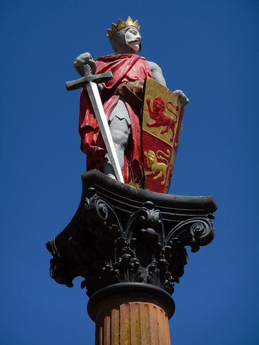 A painted statue of a knight in armour on a pillar at Conwy Castle in Wales