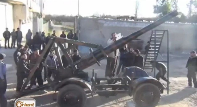 Syria-cannon-C-18km-range-2014-sfa-1
