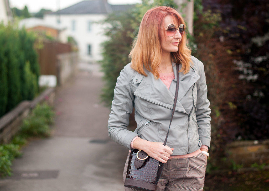 Smart but comfy autumnal dressing: Grey leather biker jacket  millennial pink sweater  brown check wide leg pants  pink snakeskin shoes | Not Dressed As Lamb, over 40 style