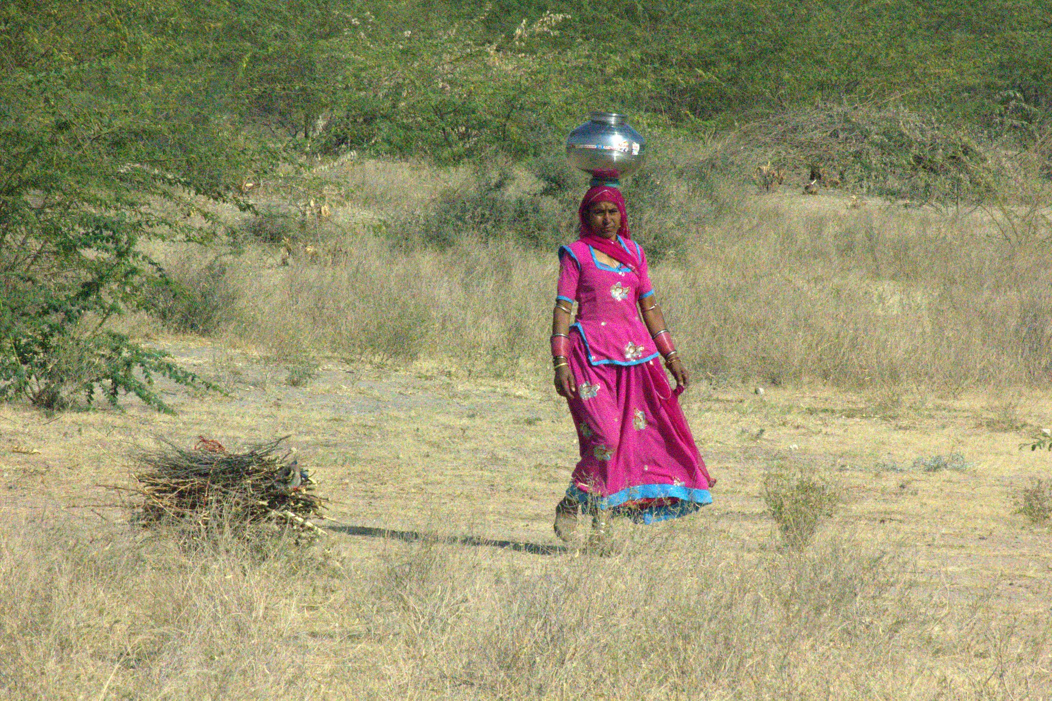 A Salawas woman walking to get water