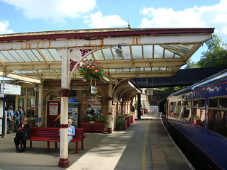 Matlock railway station with an East Midlands Trains class 156 in the platform