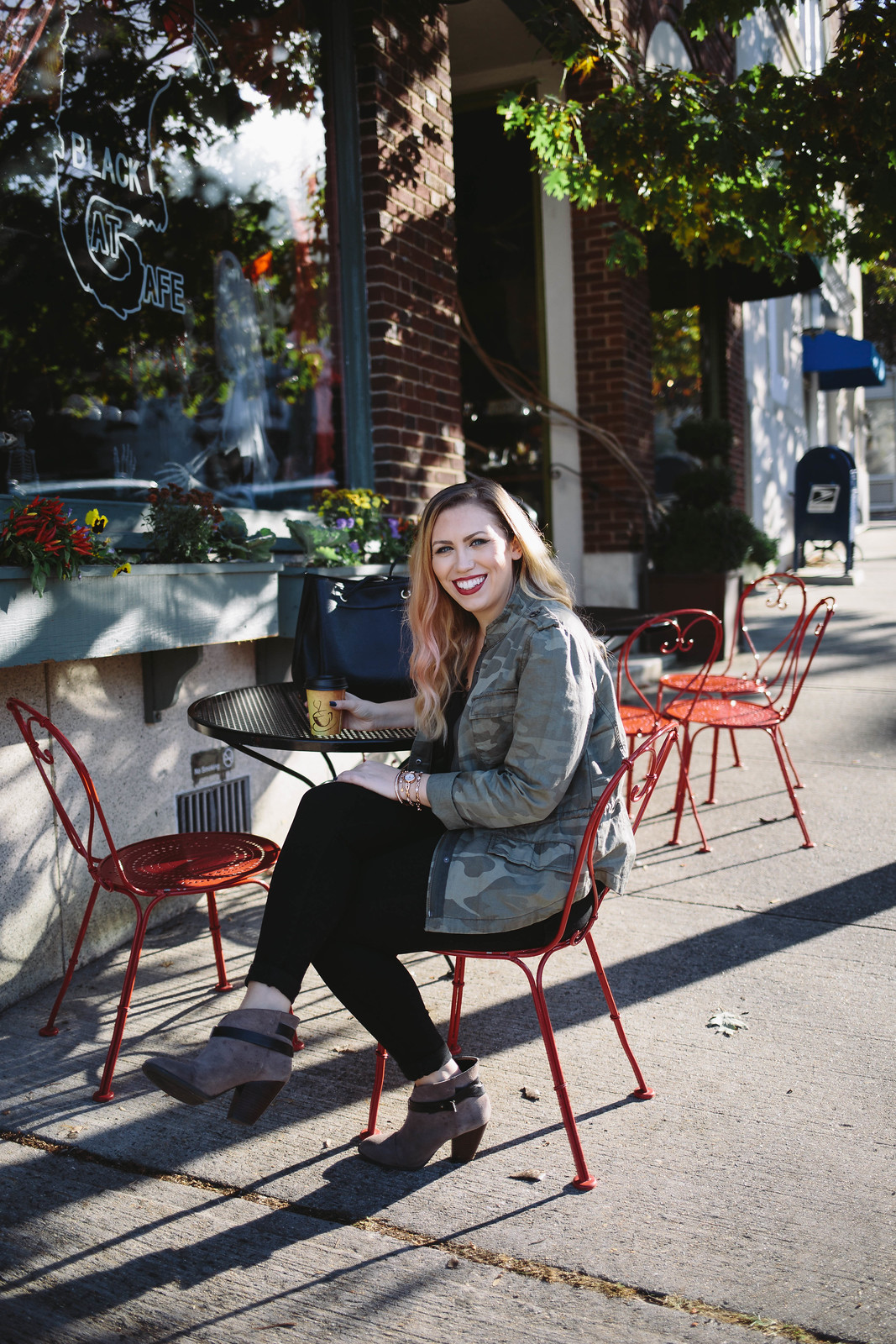 Coffee Date Outfit Camo Jacket Black Jeans Gray Booties Red Chairs Irvington New York