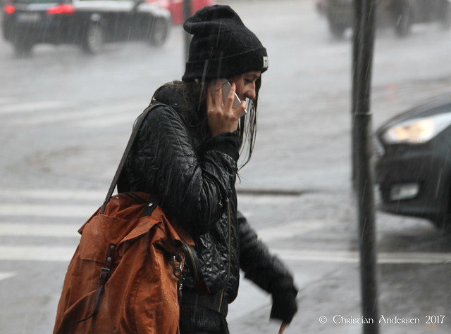... perhaps she hasn't noticed that it's raining or just doesn't care ...