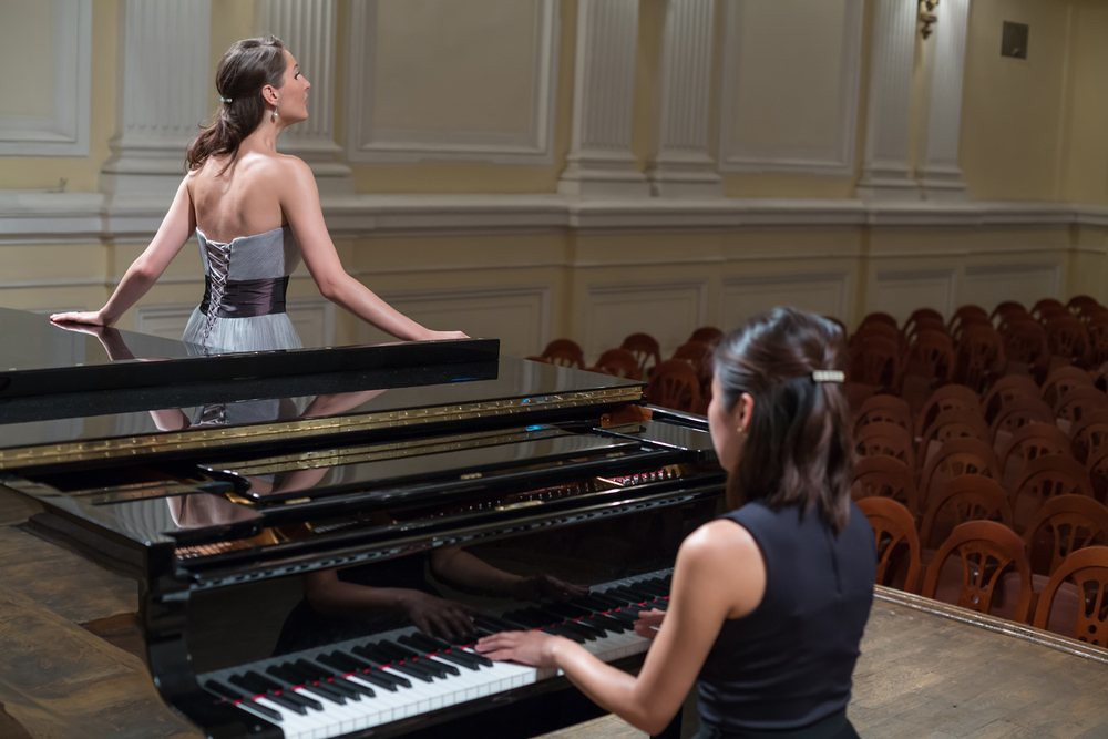 photo of singer and pianist practicing performance