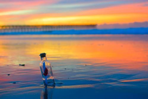 surfcity nc beach message bottle sunrise sand