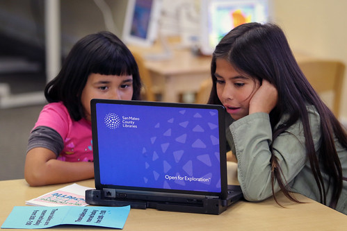 Children using a checked out laptop.