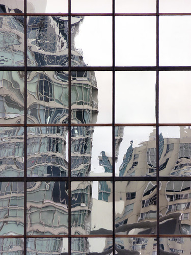 Reflection of a high-rise in another high-rise's window in Vancouver, Canada